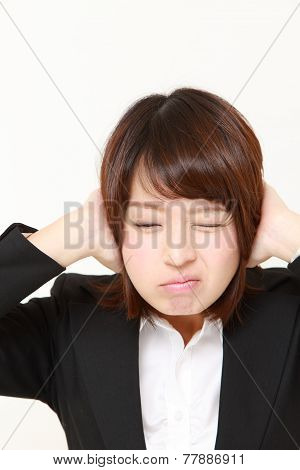 Japanese businesswoman suffers from noise