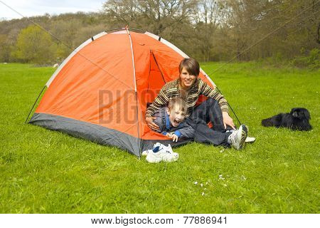 mother with children in a tent on the nature