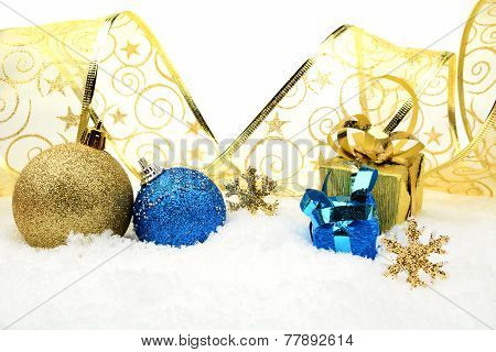 Golden And Blue Christmas Decoration On Snow