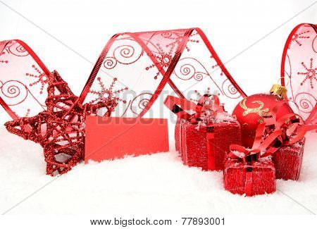 Red Christmas Decoration With Wishes Card On Snow