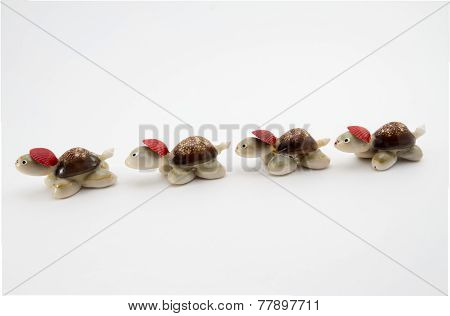 Four Turtles Made Of Shells