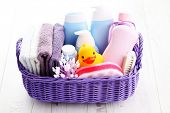 stock photo of baby duck  - basket full of baby accessories  - JPG