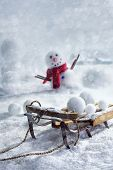 picture of sleigh ride  - Wooden sleigh and snowballs with snowman and wintery background - JPG