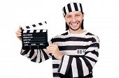 stock photo of inmate  - Funny prison inmate with movie board isolated on white - JPG