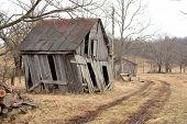 foto of shacks  - An old shack on a winter landscape - JPG