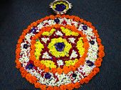 pic of kolam  - flower kolam in a onam festival during the celebrations of onam festival which is famous in the state of kerala - JPG