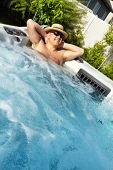 foto of hot-tub  - Man having massage in  hot tub Jacuzzi - JPG