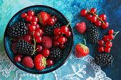 picture of mulberry  - Summer berries in bowl on a table fruits raspberry strawberry red currant and mulberry - JPG