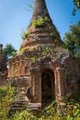 stock photo of shan  - Ruins of ancient Burmese Buddhist pagoda in the village of Indein on Inlay Lake in Shan State Myanmar  - JPG