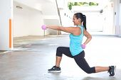 pic of hispanic  - Beautiful hispanic sport woman doing lunges with two pink dumbbell - JPG