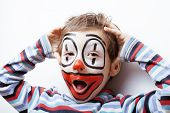 foto of pantomime  - little cute real boy with facepaint like clown - JPG