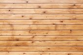 stock photo of uncolored  - Background texture of natural uncolored wooden wall made of lining boards - JPG