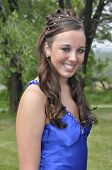 stock photo of senior prom  - Portrait of a teenage girl ready for the prom.  The girl has long dark brown hair which has been styled and she is wearing a royal blue gown.