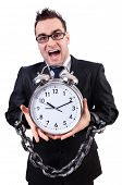 stock photo of sweatshop  - Businessman with clock isolated on white - JPG