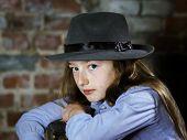 picture of schoolgirl  - Cute schoolgirl studio portrait on brick wall background - JPG