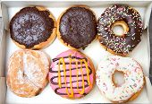 foto of donut  - Box full of doughnuts half a dozen donuts - JPG