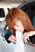 stock photo of vomiting  - concept shot of young Japanese woman vomiting by carsickness - JPG