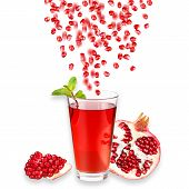 stock photo of pomegranate  - Pomegranate juice in a glass and ripe pomegranate - JPG