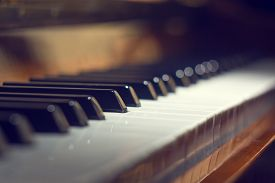 pic of classic art  - Piano keyboard background with selective focus. Warm color toned image