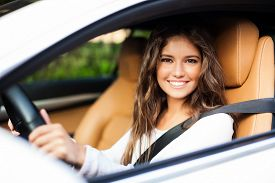 picture of steers  - Young woman driving her car - JPG