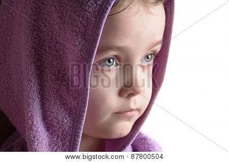 Girl head portrait wearing bathrobe hood staring right