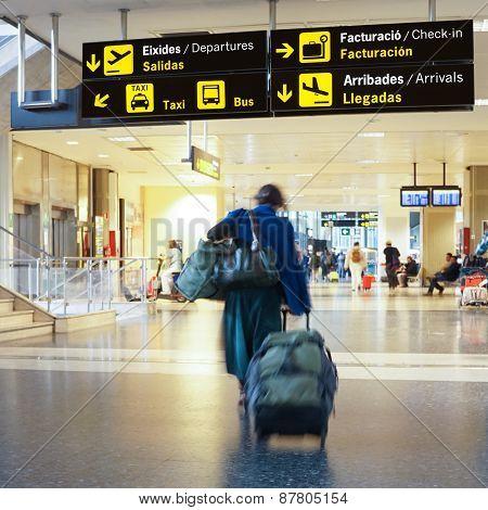Airline passengers inside an International Airport.