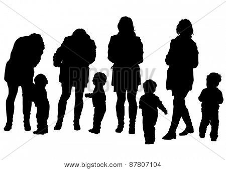 Silhouette of a mother and daughter on walk