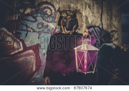 man with mask wolf and lamp with colored smoke