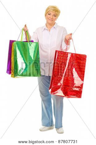 Senior woman with bags isolated