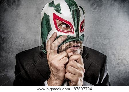 Stress, businessman angry with Mexican wrestler mask