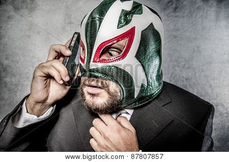 Calling, businessman angry with Mexican wrestler mask