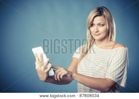 Young Woman With Tablet On Blue