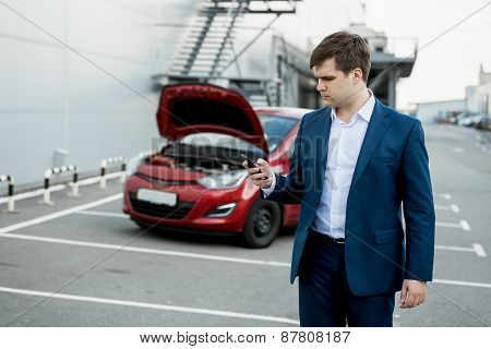Young Man Calling Technical Car Service