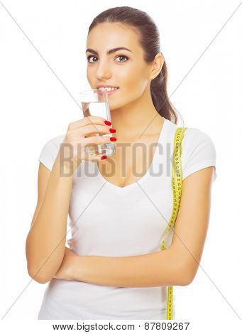 Young healthy girl with water glass isolated