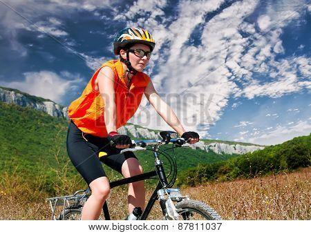 Young female riding a mountain bike outdoor