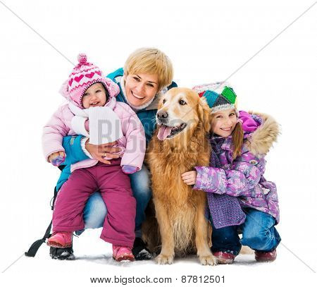 Happy family on a winter walk with the dog