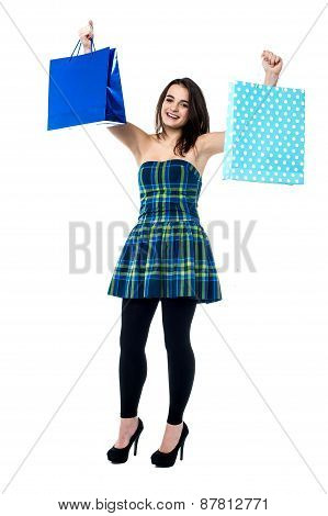 Excited Young Girl Holding Shopping Bags
