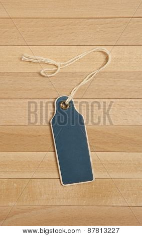 Vintage blank price tag on wooden background