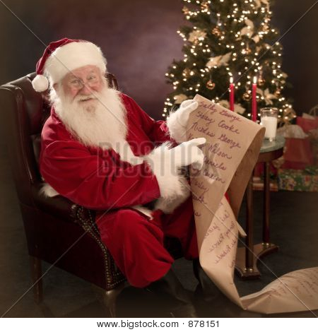 Santa Pointing To Boys And Girls List