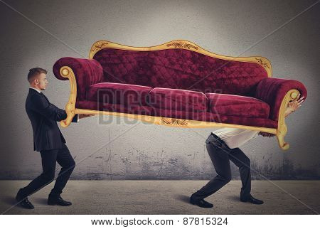 Men carrying a sofa