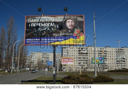 KIEV, UKRAINE - MARCH 22, 2014. Ukrainian military propaganda.Poster on billboard.Civil War in Ukraine. March 22, 2014 Kiev, Ukraine