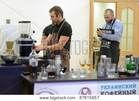 DNEPROPETROVSK, UKRAINE - JUNE 1, 2013: Barista Dmitry Shevchenko makes coffee during 5th Ukrainian Coffee In Good Spirits Championship in Dnepropetrovsk, Ukraine on June 1, 2013
