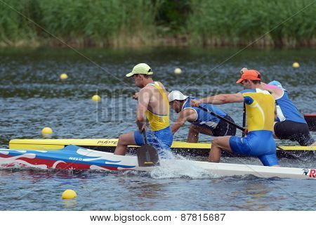 DNEPROPETROVSK, UKRAINE - MAY 29, 2013: Unidentified paddlers in canoe racing during Ukrainian paddling championships. Dnepropetrovsk rowing canal is the main Ukrainian sport arena in kayaking