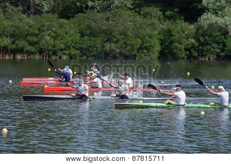 DNEPROPETROVSK, UKRAINE - MAY 29, 2013: Kayak racing during Ukrainian paddling championships. Dnepropetrovsk rowing canal is the main Ukrainian sport arena in kayaking and canoe racing