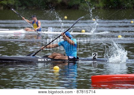 DNEPROPETROVSK, UKRAINE - MAY 29, 2013: Unidentified paddlers in kayak racing during Ukrainian paddling championships. Dnepropetrovsk rowing canal is the main Ukrainian sport arena in kayaking