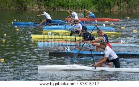 DNEPROPETROVSK, UKRAINE - MAY 29, 2013: Canoe racing during Ukrainian paddling championships. Dnepropetrovsk rowing canal is the main Ukrainian sport arena in kayaking