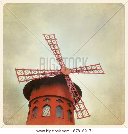 The famous Moulin Rouge in Paris, France. Filtered to look like and aged, instant photo