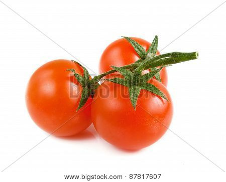 Three Cherry Tomatoes On A White Background.