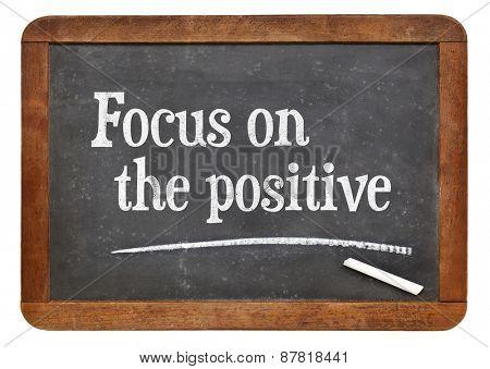 Focus on the positive - inspirational advice n on a vintage slate blackboard