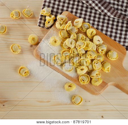 Uncooked Italian Ravioli On  A Wooden Table.